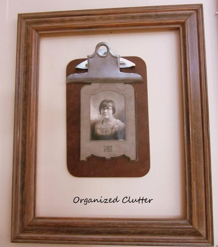 Clipboard Photo Wall www.organizedclutterqueen.blogspot.com