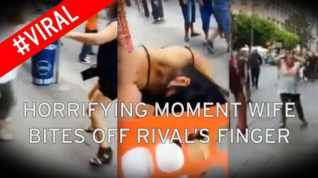 A Furious Wife Bites and Severed The Finger of Her Husband's Lover in a Street Free For All Brawl See It to Believe it!!!