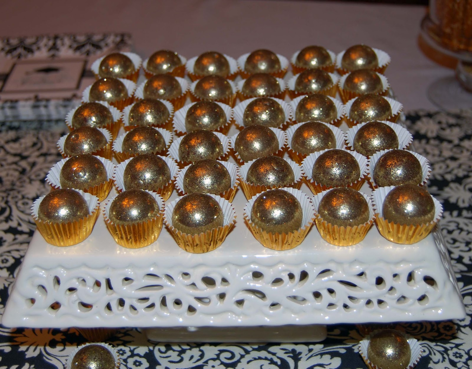 Milk chocolate bonbons with caramel filling and covered in edible gold