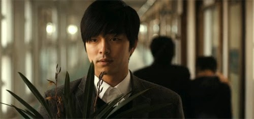 Kang In Ho stands conflicted as teacher Park Bo Hyun, played by Kim Min Sang walks student Min Soo down the hall.