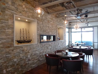 Stacked gray stone with art niches for model boats new feature at Snug Harbour in Port Credit.