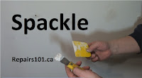 using a putty knife to measure out spackle