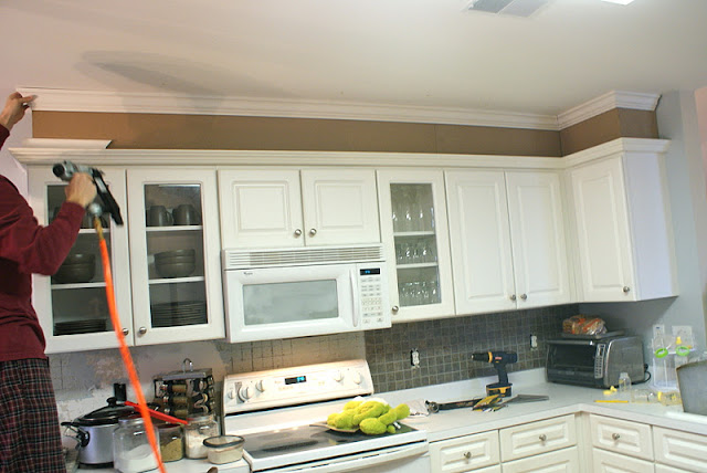 Saved by suzy feature friday anne from hello newman 39 s for Adding crown molding to kitchen cabinets before after