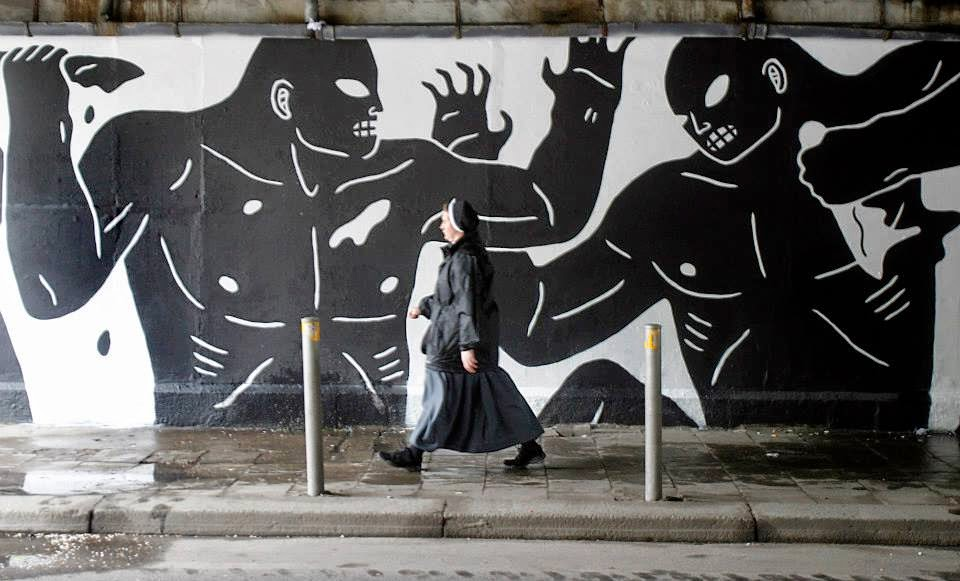 Cleon Peterson spent the last few days working on the streets of Poland for the Street Art Katowice Festival.