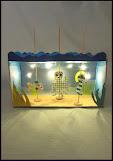 Dukketeater med lys i