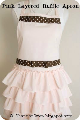 handmade pale pink ruffled apron with polka dot bow accent