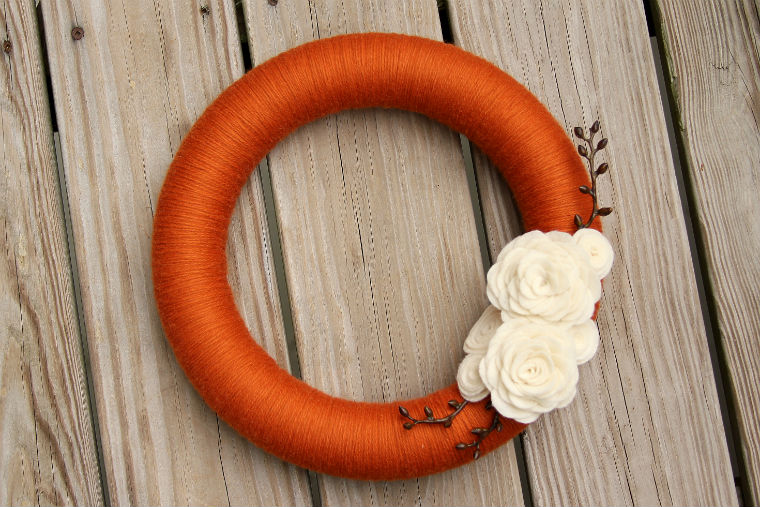 DIY orange wreath with white felt flowers