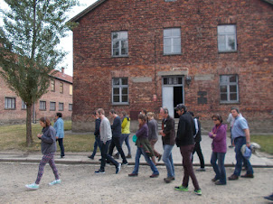 """Visitors on guided tour of """"Auschwitz-I"""" concentration camp complex."""