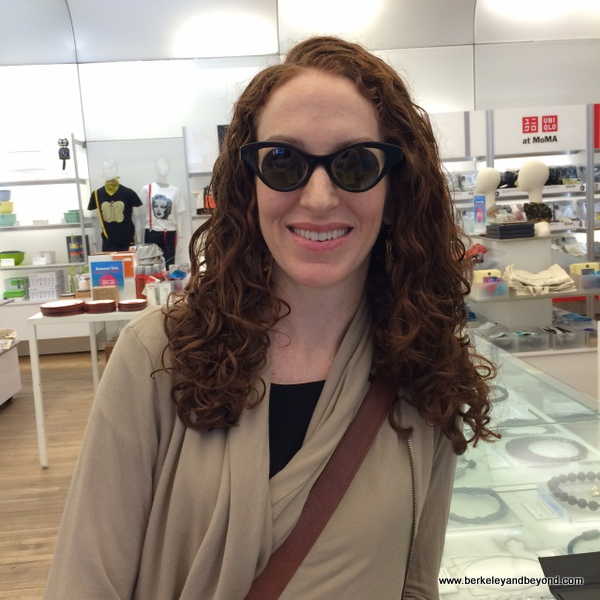 dazzling customer in Andy Warhol round sunglasses at ShopMoMa in NYC