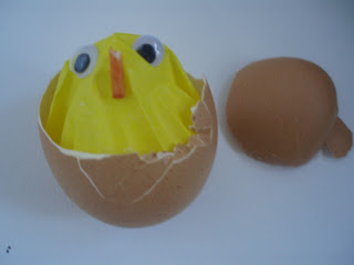 Hatching chick, using an egg shell and yellow cupcake paper