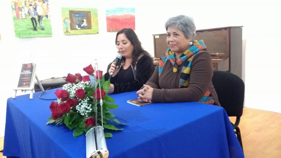 Junto a la poeta  Marcela Reyes Harris