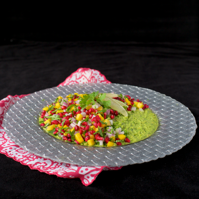 This Mango and Pomegranate Guacamole can be served with tortilla or pita chips, on crostini, or as a lovely, unique side dish. It's always sure to dazzle!