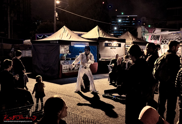 An Elvis impersonator entertains onlookers at the vibrant West End night markets. Photo by Kent Johnson.
