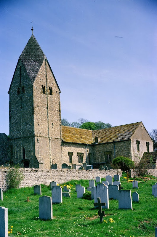 St. Mary's Church, Sompting, West Sussex.  This church with its rare but distinctive Saxon tower with a 'gabled pyramidal cap' or Rheinish Helm (Rhineland Helmet) is suggestive of early German (Saxon) architectural influence. Nevertheless it is built principally of flint nodules and local sandstones from the Weald Clay Formation. The walls of Sompting Church are built mainly of undressed flint nodules. The quoins are of a variety of rock types, some possibly derived from older buildings. The nave and transept are roofed with thin sandstone slabs from the Weald Clay. The unusual tower of this church is an important Saxon structure. Many of the churches of West Sussex were principally constructed from locally 'quarried' flints, the only suitable building stone readily available. The Rheinish Helm on top of the tower is an original Anglo-Saxon spire, the only one in the country.
