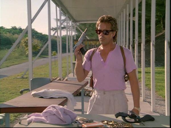 don-johnson-as-sonny-crockett-holding-a-