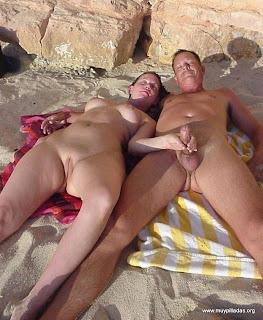 Pilladas playa pareja