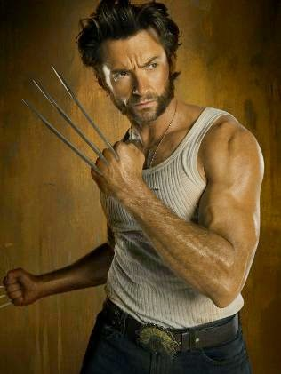 High Jackman as Wolverine in black jeans, white vest and claws