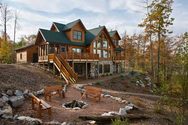 Beyond the aisle home envy log cabins for Stone and log homes