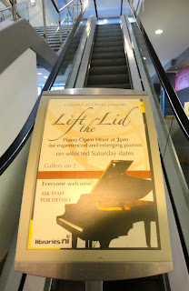 Poster for Lift the Lid piano open hour in Lisburn Library
