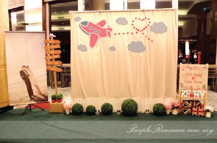 Photo Booth Backdrop Decoration, Wooden Signage with country names, wedding poster, welcome board, white fences, green carpet, initial, london theme bag, passport stamps with world each country, aeroplane backdrop with clouds, garden theme, love birds, wedding decoration, Mandarin Oriental Hotel, Kuala Lumpur, Selangor, idea, travel around the world