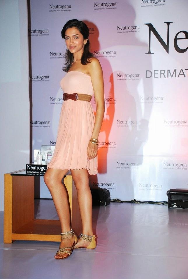 Deepika Padukone at the neutrogena launch im peach color mini skirt getting kissed