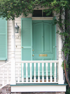 teal blue front door shutters