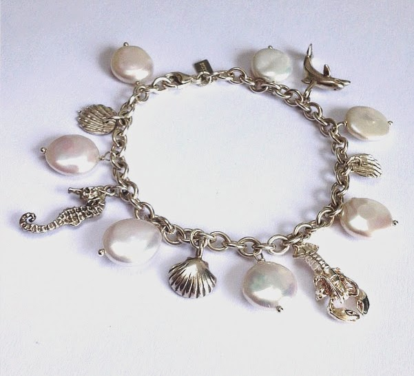 https://www.etsy.com/listing/191245288/beach-bracelet-lobster-dolphin-seahorse?ref=shop_home_active_4