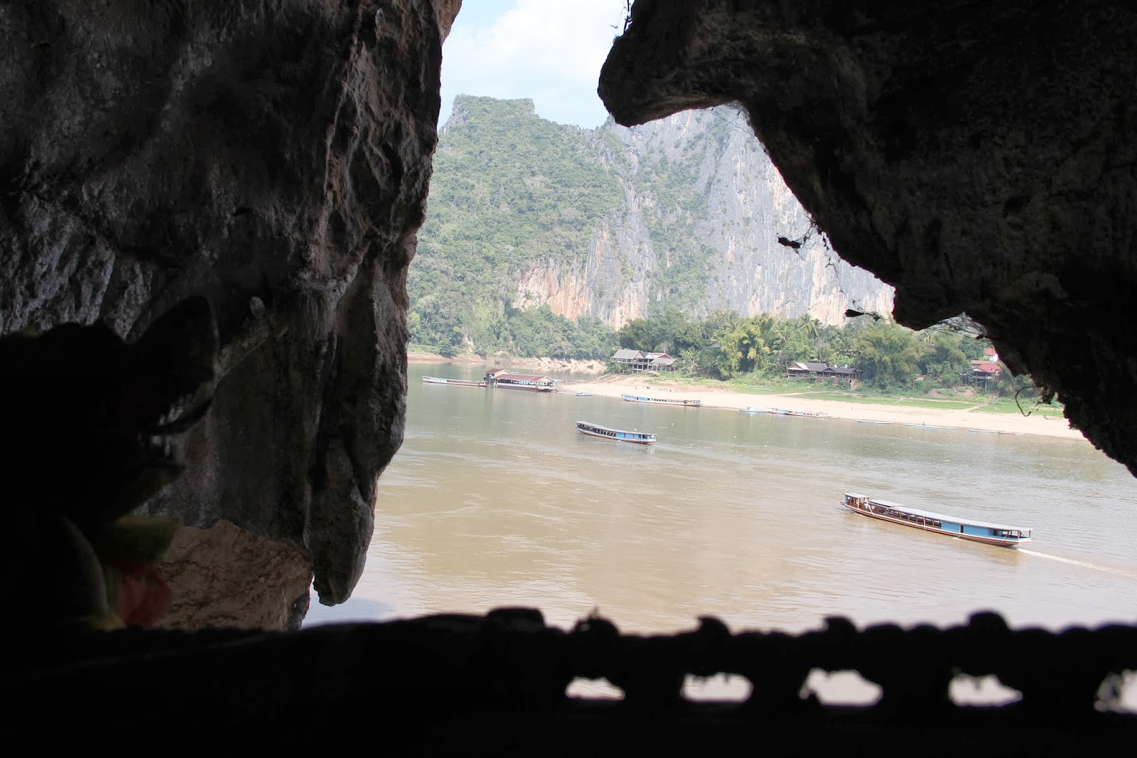 View from the Pak Ou cave across the Mekong River to the mouth of the Nam Ou River in Laos.