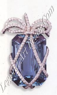 A 6o carat aquamarine brooch wrapped in diamonds