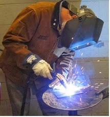 A welder wearing welding cloth