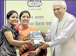 Telecom and HRD minister Kapil Sibal launching Aakash Worlds cheapest Tablet