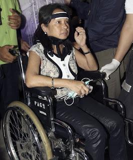 Gloria Macapagal Arroyo on wheelchair.