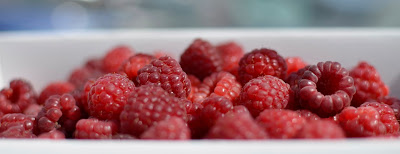 image of red raspberries in white basket
