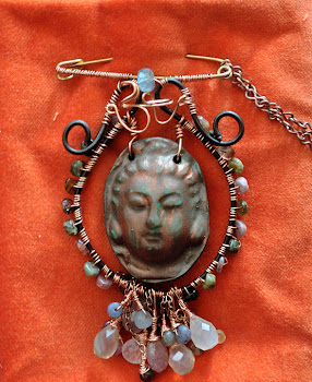 Quan Yin /Om sculpture necklace converts to broche