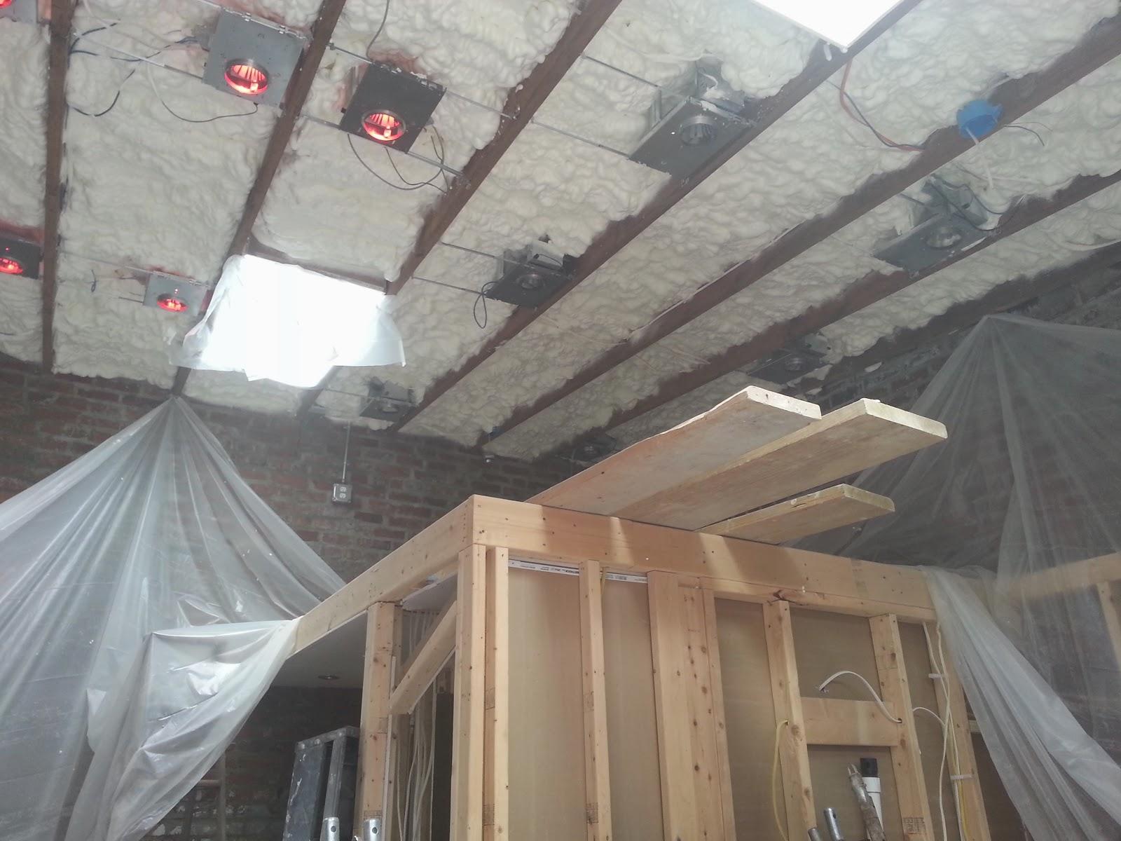 18-Insulation-sprayed-imgur-Storage-Unit-Renovation-in-Tiny-Architecture-www-designstack-co