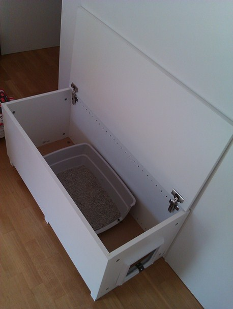 cat litter box in a living room why not get home. Black Bedroom Furniture Sets. Home Design Ideas