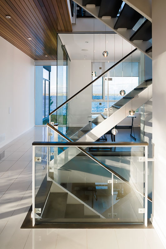 Glass stairs in Amazing Ottawa River House by Christopher Simmonds Architect