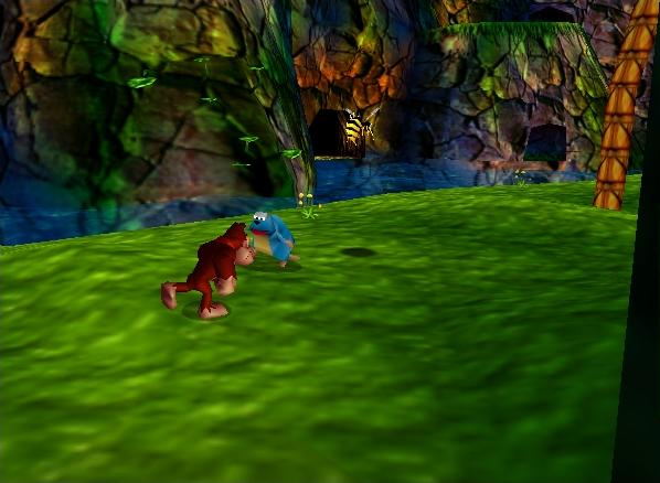 "A screenshot of the ""Jungle Japes"" level in Donkey Kong 64. The titular ape can be seen running on a grassy area, with a beaver in front of him. In the distance, we can see a river, a cliff, and a tree."