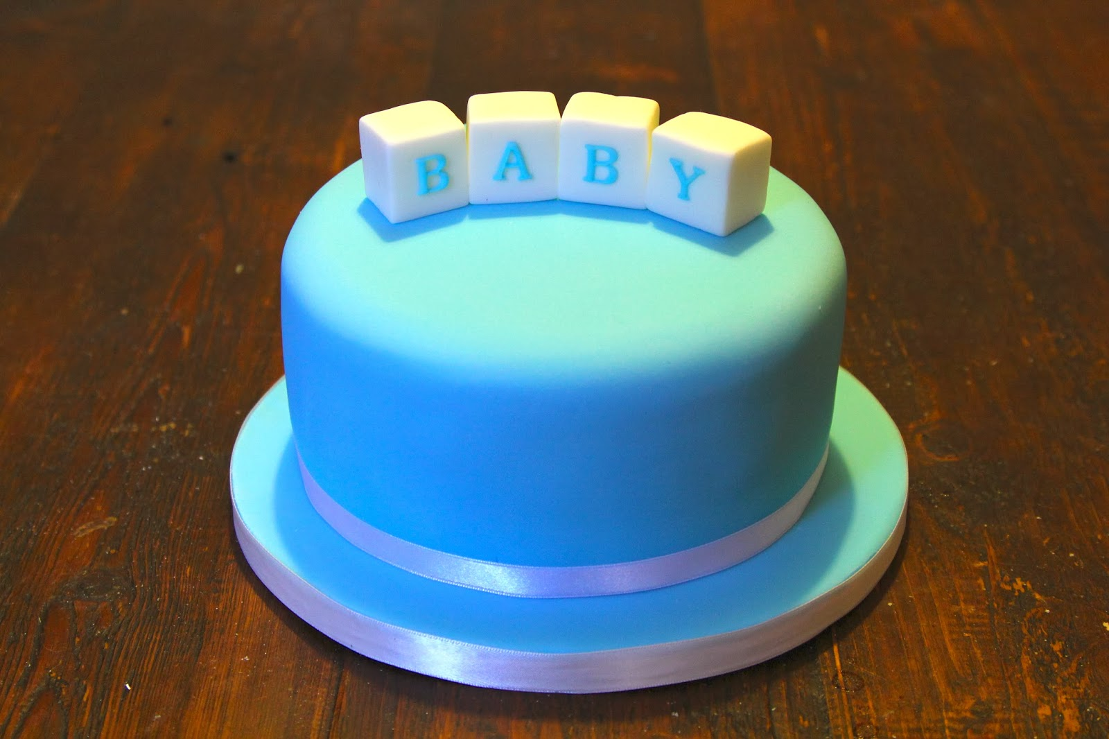 Blue baby blocks cake for shower