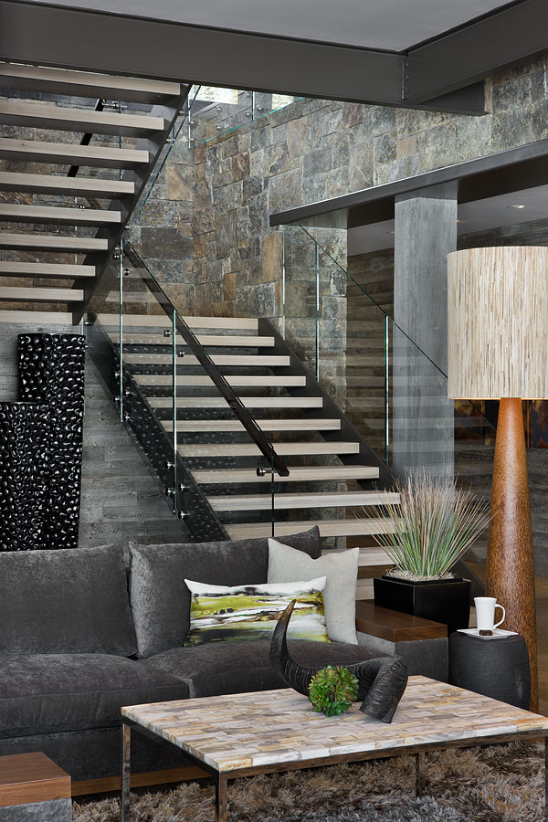 Modern stairs in Elegant Mountain Home by Reid Smith Architects