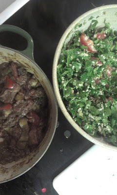 lamb stew in a pot, tabouleh in a bowl