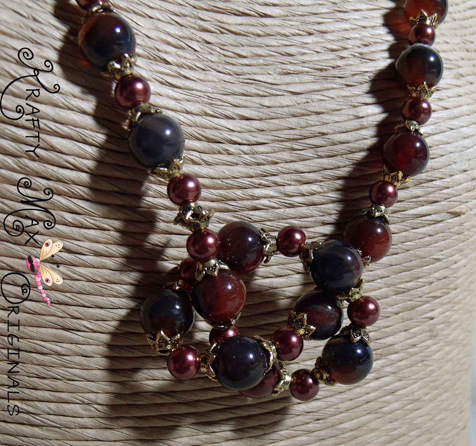 http://www.lajuliet.com/index.php/2013-01-04-15-21-51/ad/gemstone,92/exclusive-deep-mahogany-gemstone-and-burgundy-glass-pearls-with-gold-plated-findings-a-krafty-max-original-design,297