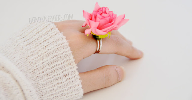Modeled photos of the pink rose-shaped 3D floral ring from Born Pretty Store.