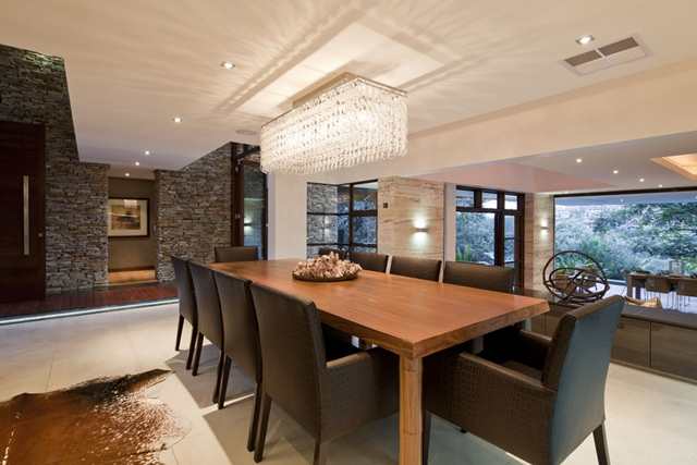 Dinning room with dinning table and black chairs in the Contemporary South African SGNW House by Metropole Architects