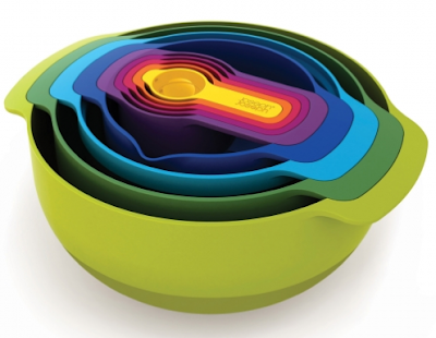 nesting set of bowls, colander, sieve and measuring cups, in bright colors
