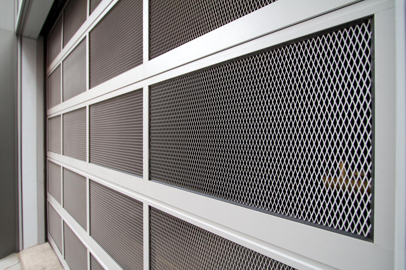 An industrial garage door can be dangerous to untrained workers