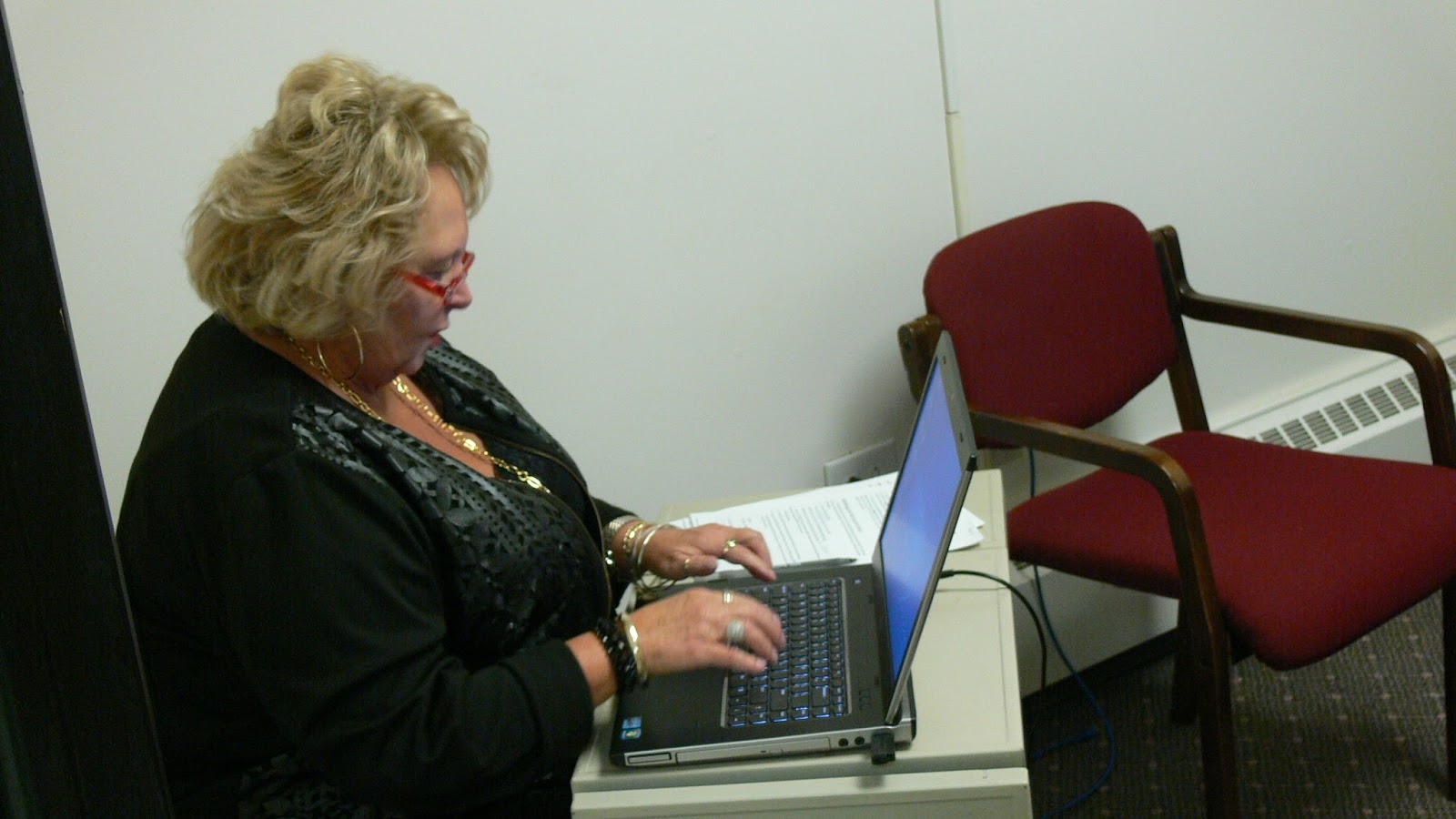 Board of Elections Director Debbie George updates the state website with the eligible provisional ballot totals