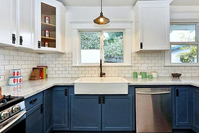 , and the kitchen is not off limits Consider navy cabinets