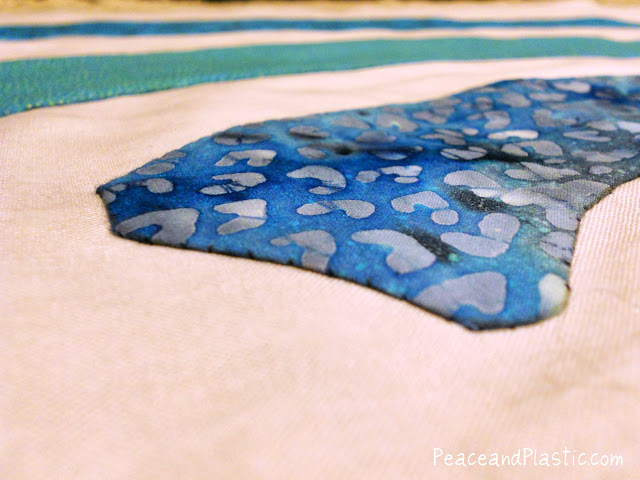 A close up photo of hand needle-turn applique on a WiFi Quilt