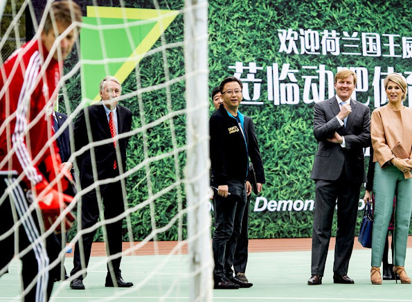 Queen Maxima and King Willem-Alexander of The Netherlands visit the Sino-Dutch Diary Development Center on October 25, 2015 in Beijing, China.